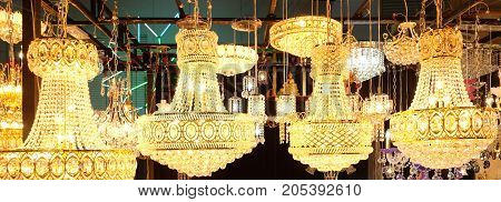 Beautiful of crystal chandelier. Sparkle chandelier and gold light.
