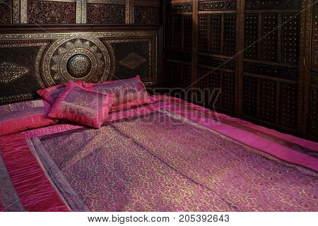 Wood carved bed with Mattress made of silk and wood partition.