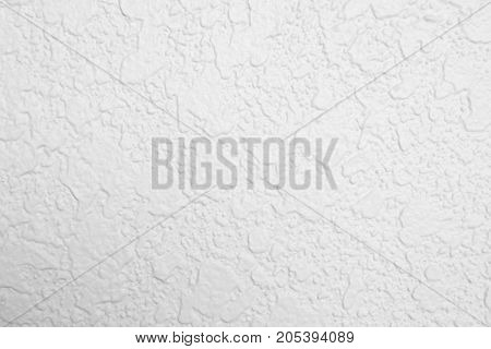 Detail of white cement rough texture. Pattern of white cement rough.