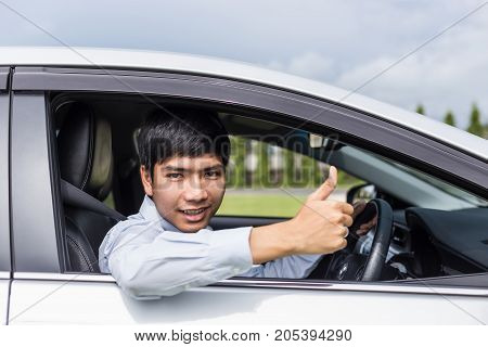 Asian Businessman Sitting In The Modern Car. For Car Rent Or Car Business Concept