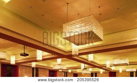 Chandelier and gold light in the room.