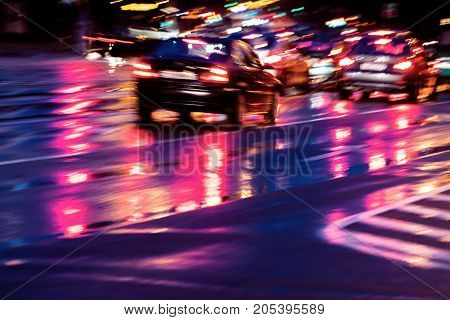 Blurred City Traffic With Colorful Bright Headlights