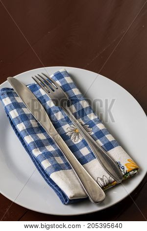 Silverware On The Dishcloth, Metal Fork And Knife On The White Plate With Dishtowel