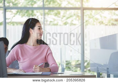 Bussiness concept Bussiness woman working with bill on wooden table.