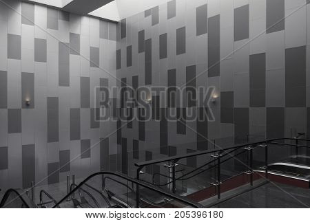 Grey tone of wallpaper with foreground by escalator.
