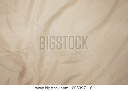 Crease on fabric Beige color. Background and texture of fabric.