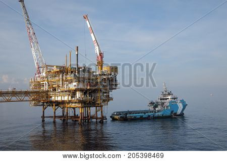 Supply boat (crew boat) transfer cargo to oil and gas industry at offshore and moving cargo from the boat to the platform.