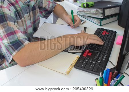 Man or Businessman working on White Desk. Businessman financial inspector Accountant workplace. Man Analysis Business Accounting