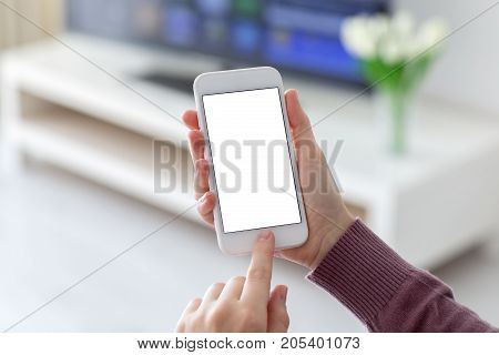 Female hands holding phone with isolated screen in room home