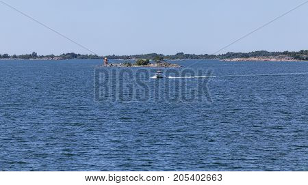 BALTIC SEA, ALAND ON JUNE 29. View of a sailboat, the Baltic Sea and the archipelago on June 29, 2017 in Aland, Finland. Sunny day at sea. Unidentified boat. Editorial use.