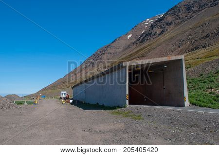 Olafsfjordur road tunnel through a mountain in Iceland
