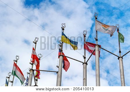 Flags Of Different Countries On Blue Sky Background