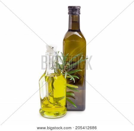Two different glass bottles of the olive oil and olive branch on a white background