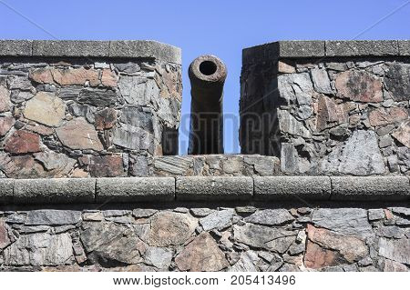 Old cannon behind the fortress wall in Colonia del Sacramento Uruguay