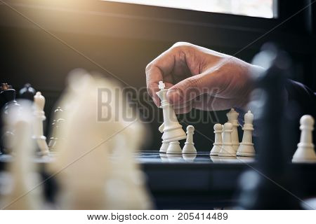 Close up of hands confident businessman colleagues playing chess game to development analysis new strategy plan leader and teamwork concept for success.