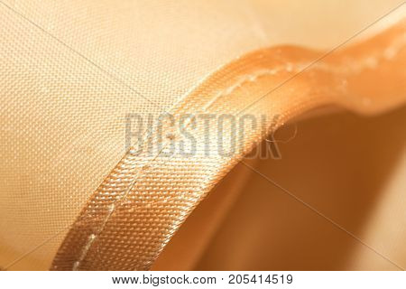 golden fabric as a background. macro . Photo of an abstract texture