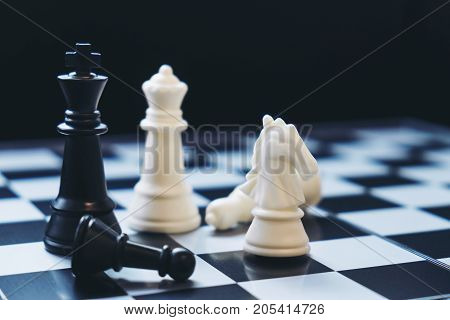 Chess pawns on the chessboard with selective focus