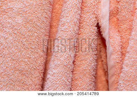 background of pink terry towels . Photo of an abstract texture