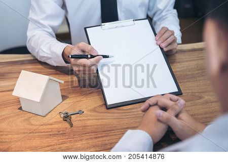 Business Signing a Contract Buy - sell house insurance agent analyzing about home investment loan Real Estate concept.