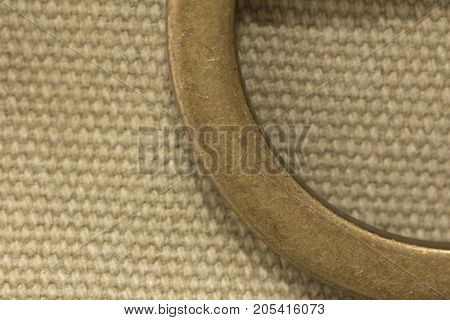 Metal buckle on the fabric . Photo of an abstract texture