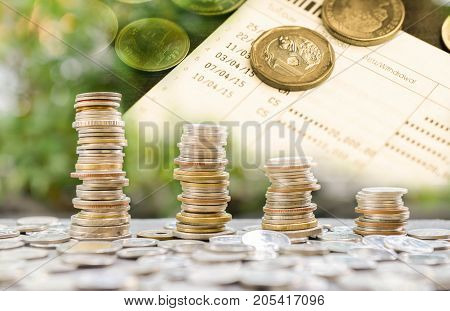 Coins stacks duplicate layer with coin on book bank account - Concept of saving money