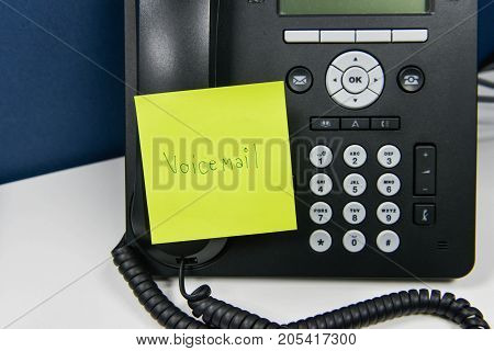 Paper note with voice mail wording is sticked on the IP Phone