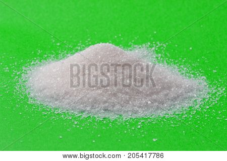 sugar on a green background. macro . Photo of an abstract texture