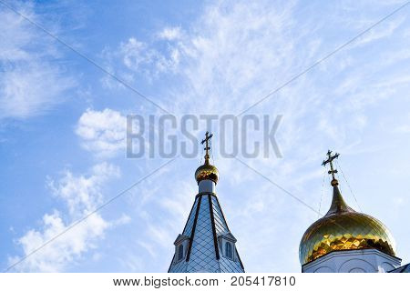 The domes of the Orthodox Church against the blue sky. Russia. Moscow region