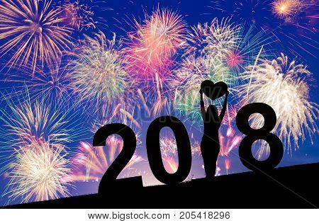 Colorful Fireworks on blue and purple twilight background to celebrate 2018 new year eve occasion or events with woman silhouette holiday celebration concept