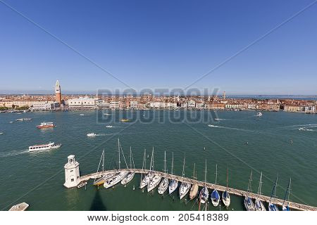 VENICE ITALY-SEPTEMBER 21 2017 : St Mark's Campanile and gothic Doge's Palace on Piazza San Marco aerial view. Bell tower is one of the most recognizable symbols of the city.