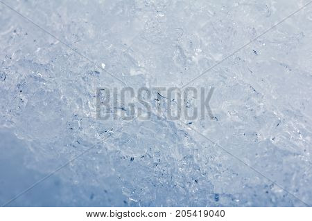 Background of blue ice . Photo of an abstract texture