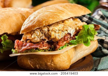 Ciabatta Sandwich With Smoked Bacon And Eggs