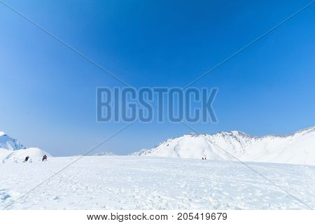 The snow mountains of Tateyama Kurobe alpine with blue sky background is one of the most important and popular natural place in Toyama Prefecture Japan.