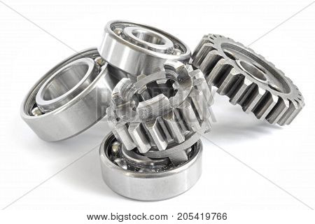 Gears and bearings on the white background.