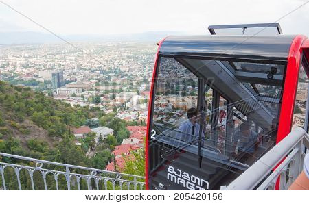 TBILISI, GEORGIA - AUGUST 08, 2013: Funicular car in Tbilisi, capital of Georgia, which connects the old town to Mtatsminda mountain