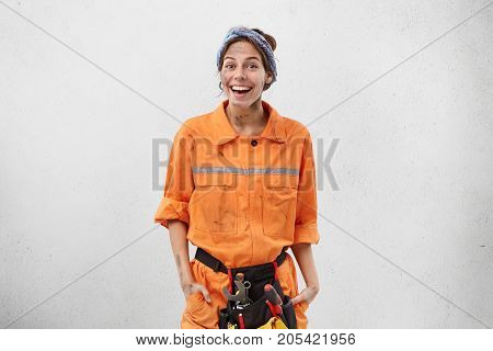 Glad Female From Working Service, Repairs Air Conditioning, Looks Happy And Excited, Likes Her Job,