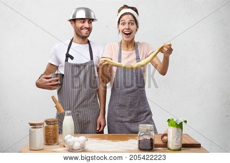 Funny Bearded Man And Girlfriend Foolish At Kitchen As Bake Cake For Mother`s Anniversary, Stretch D