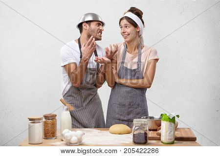 Funny Man Begs Wife To Work Alone, Looks With Nervous Expression. Friendly Lovely Couple Foolishes A