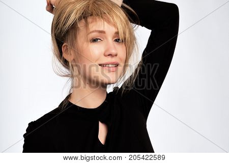 Glamour fashion woman with long blonde hair and natural evening makeup wear black dress. Prepare for party.