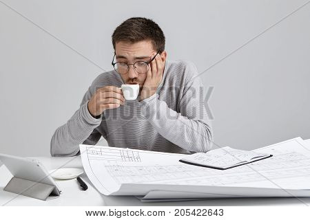 Stylish Businessman Or Design Worker, Has Coffee Break After Hard Work At Creating Sketches, Drinks