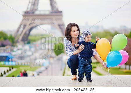 Happy Family Of Two With Bunch Of Colorful Balloons In Paris