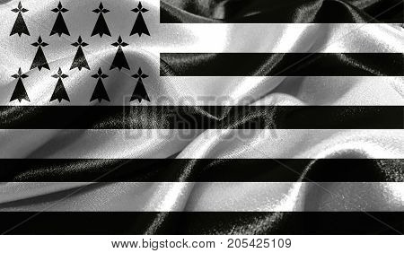 Realistic flag of Brittany on the wavy surface of fabric. This flag can be used in design