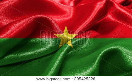 Realistic flag of Burkina Faso on the wavy surface of fabric. This flag can be used in design