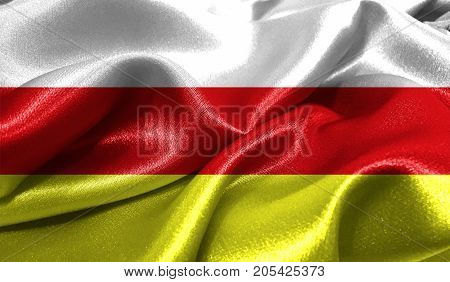 Realistic flag of South Ossetia on the wavy surface of fabric. This flag can be used in design