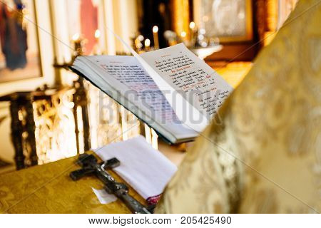 Christian Priest Reading Church Book, Priest Reads A Pray Over The Bible