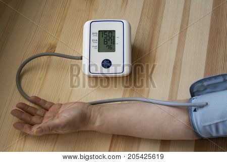 Measurement of blood pressure by an electronic tonometer. Treatment of Hypertension.