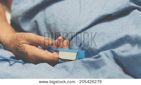 Patient In The Hospital With Pulse Gauge On Finger