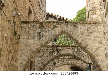 Stone arches at the street of Besalu a town in the comarca of Garrotxa in Girona Catalonia Spain.