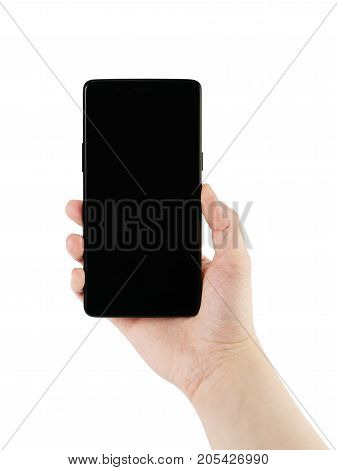 young female hand holding smartphone with black screen isolated on white background