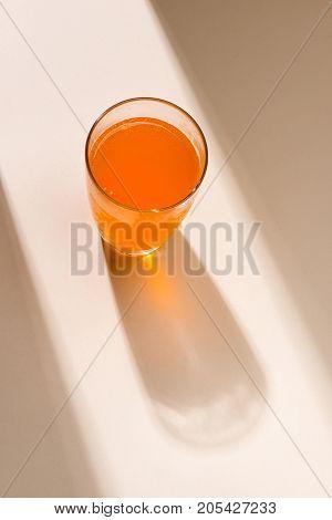 Soft drink. A glass of orange soda with ice